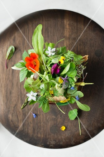 Salad with fresh flowers and amaranth wafers