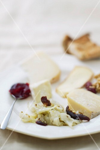A cheese platter with a fennel and date salad