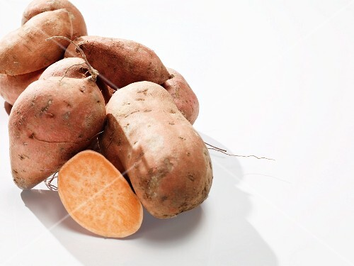 Sweet potatoes, whole and sliced