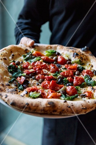 Marinara pizza with chicory being served