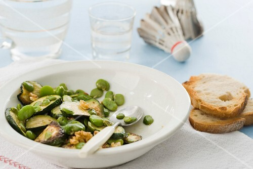Warm salad of broad beans and courgettes