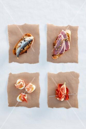 Sardine crostino, duck breast crostino, quail's eggs with ham and figs with chorizo