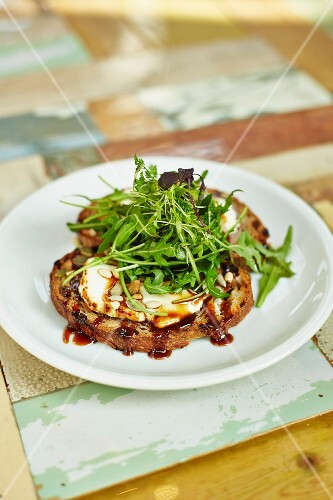Two cheese crostini with rocket