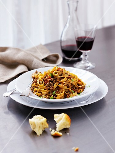 Tagliatelle with beef bolognese served with foccacia and red wine