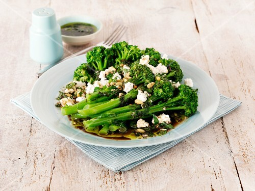 Broccoli salad with feta cheese, pine nuts and vinaigrette