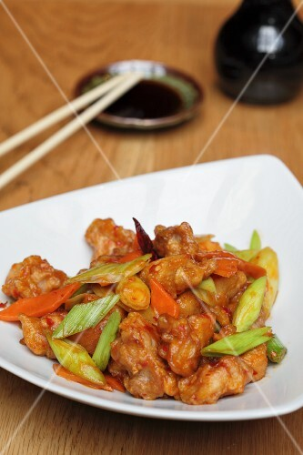 Sweet-and-sour prawns with carrots and spring onions (Asia)