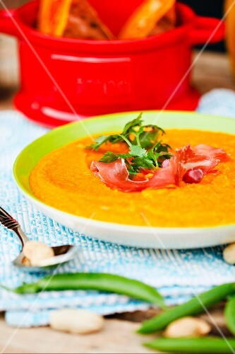Pumpkin soup with bacon and herbs