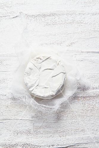 Camembert on a muslin cloth