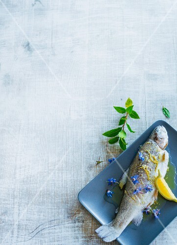Poached trout with borage flowers