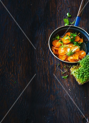 Steamed root vegetables with cress