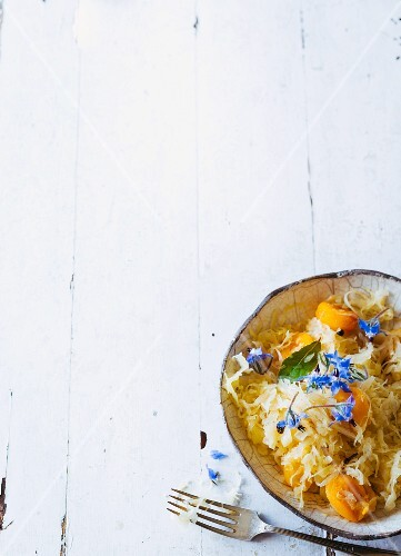 Braised sauerkraut with apricots and borage flowers