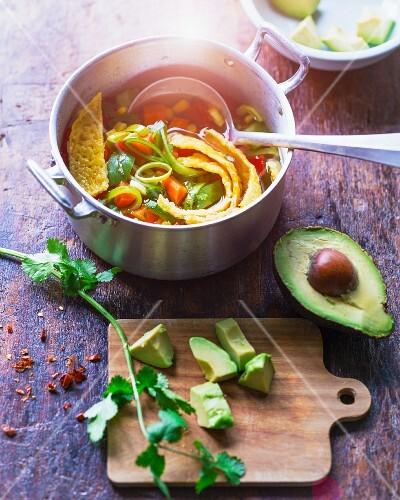 Mexican tortilla soup with sweetcorn, avocado and fresh coriander