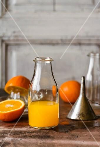 A bottle of freshly pressed orange juice