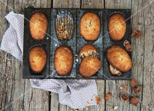 Hazelnut madeleines in a baking tin