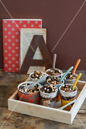Chocolate mousse with chocolate pearls in paper cups