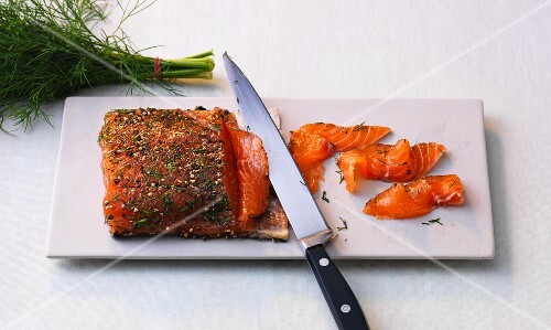 Homemade marinated salmon with dill, sea salt and pepper