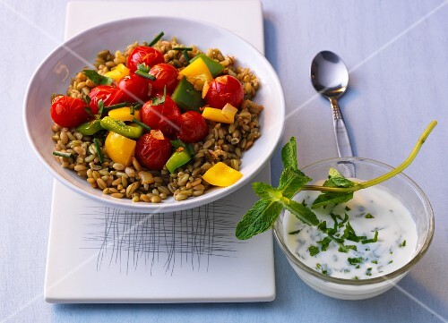 Fried vegetables and unripe spelt grains with mint yogurt