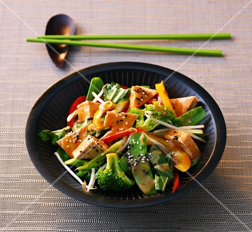 Stir fired vegetable and tofu curry with bean sprouts and sesame seeds