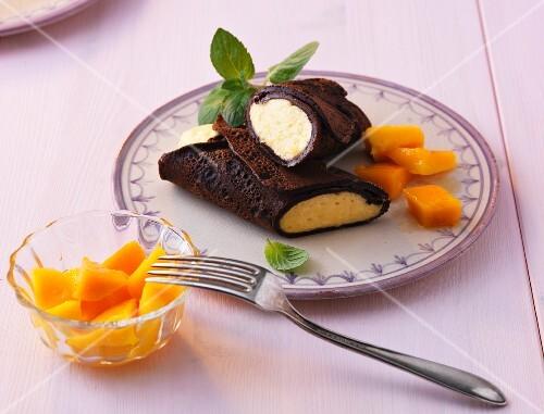 Chocolate pancakes filled with mango cream