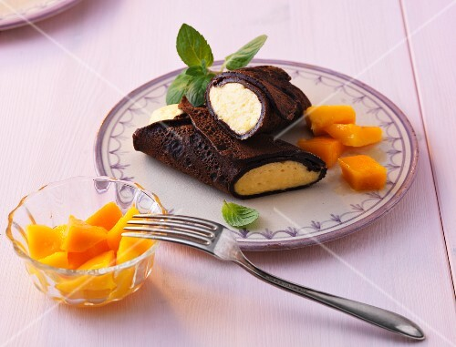 Chocolate pancakes filled with mango cream