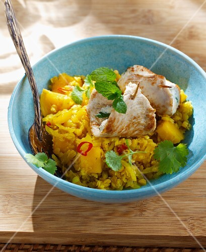 Stuffed chicken roulade with red lentils, mango and fresh chillis