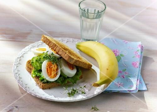 An egg sandwich with pesto and avocado