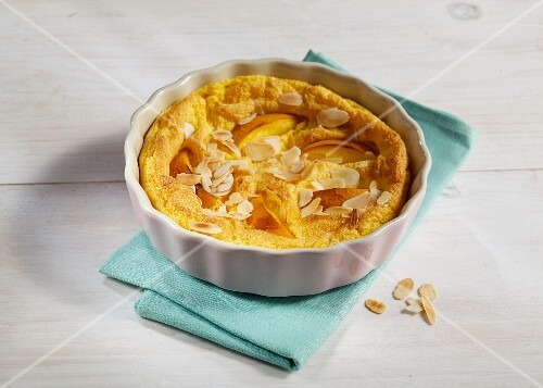 Peach and polenta bake with banana and flaked almonds