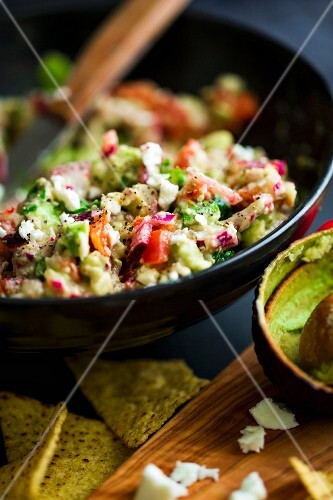 Avocado salsa with black pepper and tortilla chips