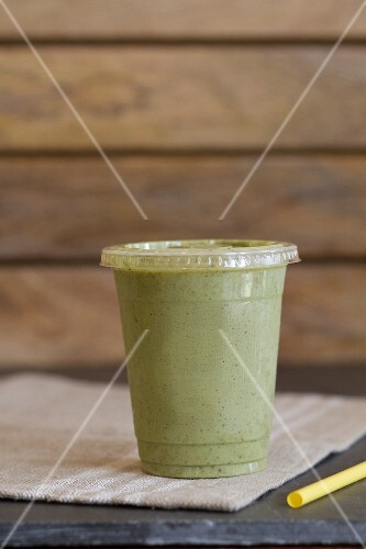 A smoothie made with kale, spinach, coconut water, bananas and chia seeds