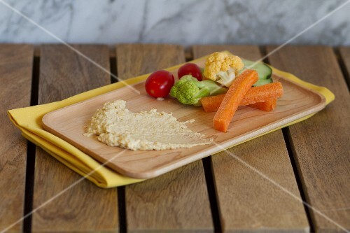 A plate of hummus and vegetables