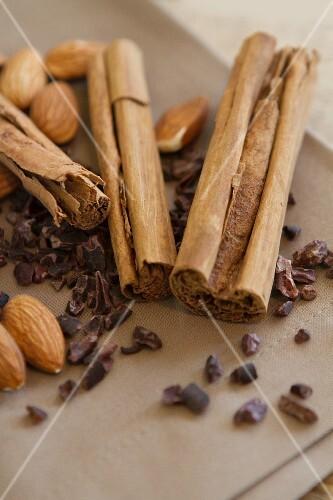 Cinnamon sticks, almonds and cacao nibs