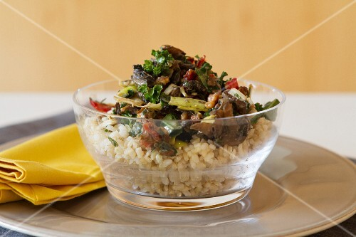 Rice salad with Portobello mushrooms, roasted peppers, dried tomatoes, kale and walnuts