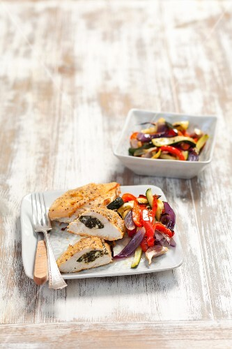 Chicken breast stuffed with spinach and feta served with oven-roasted vegetables