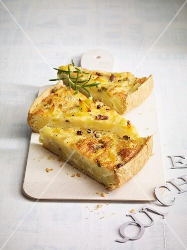 Three slices of potato and anchovy quiche