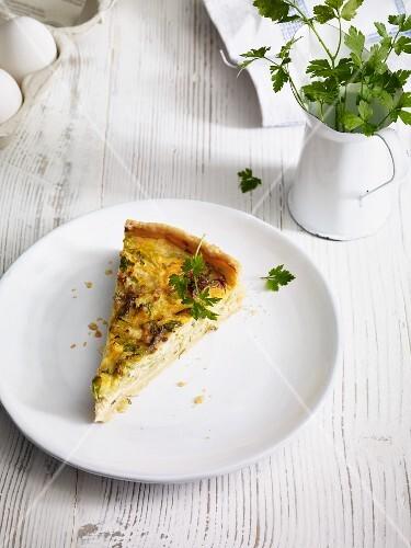A slice of cabbage and gorgonzola quiche