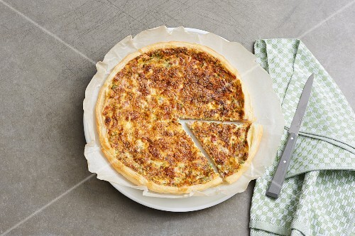 A puff pastry quiche, sliced