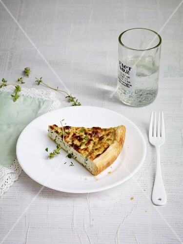 A slice of ricotta and herb quiche
