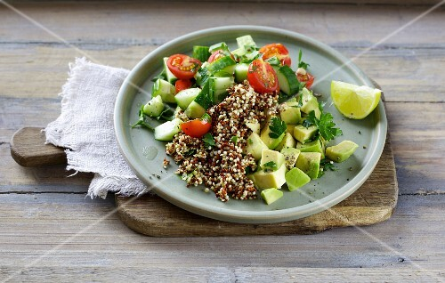 A colourful quinoa salad with avocado, tomatoes and cucumber