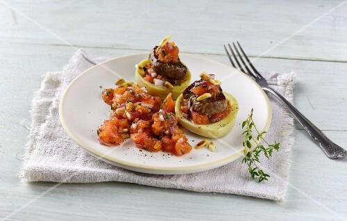 Lamb fillet in stuffed artichoke hearts with tomato salsa
