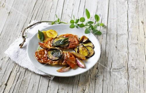 Saltimboca with an aubergine and shallot medley