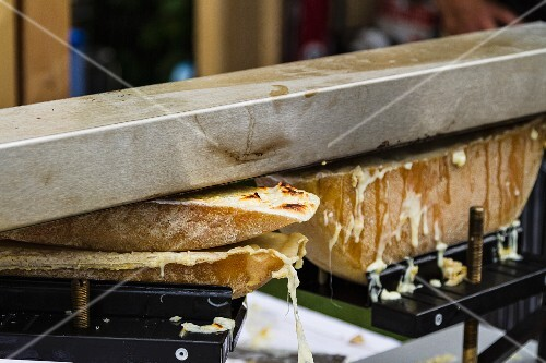 Raclette cheese being warmed