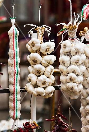 Strings of garlic at a market