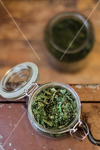 A dried herb mixture in a preserving jar
