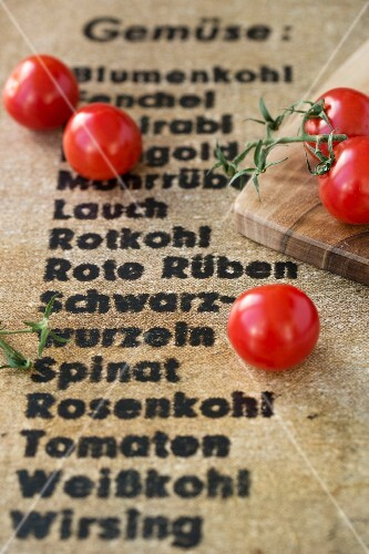 Cherry tomatoes on a board