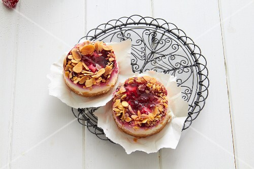Raspberry tartlets with almonds on paper