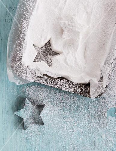 A cut-out white sugar star