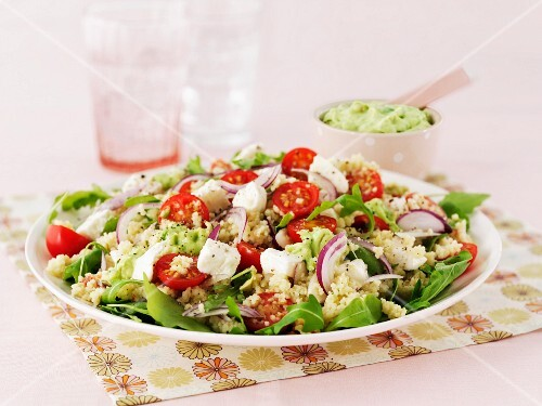 Couscous salad with feta cheese, tomatoes and guacamole