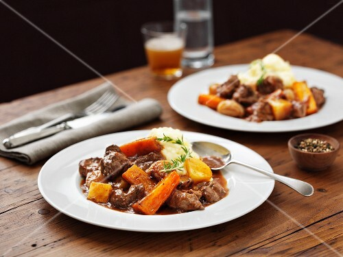 Lamb stew with mashed potatoes, carrots and beer