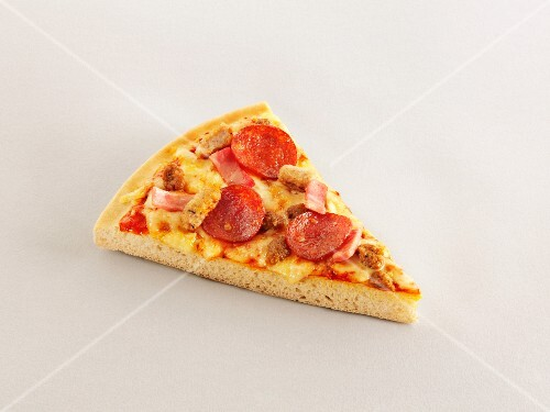 A slice of ham and sausage pizza