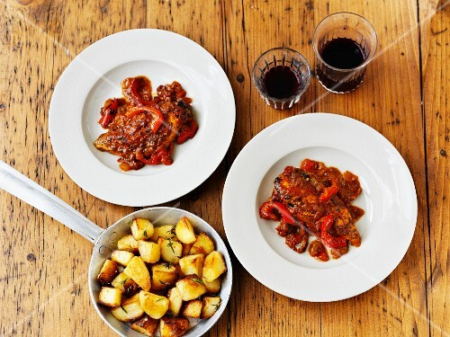 Piri-piri chicken with roast potaotes and wine (seen from above)